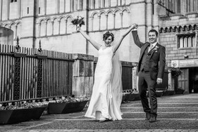 Happy Bride and Groom walking over bride at Norwich Castle
