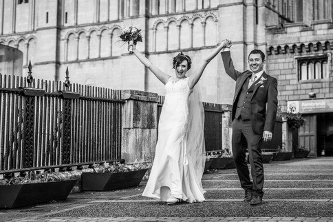 Happy Bride and Groom walking over bride at Norwich Castle