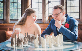 Bride and Groom playing Chess at Woodhall Manor