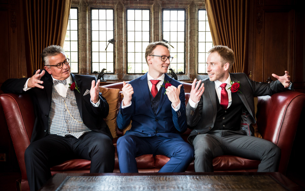 Groomsmen relaxing in the bar at Woodhall Manor