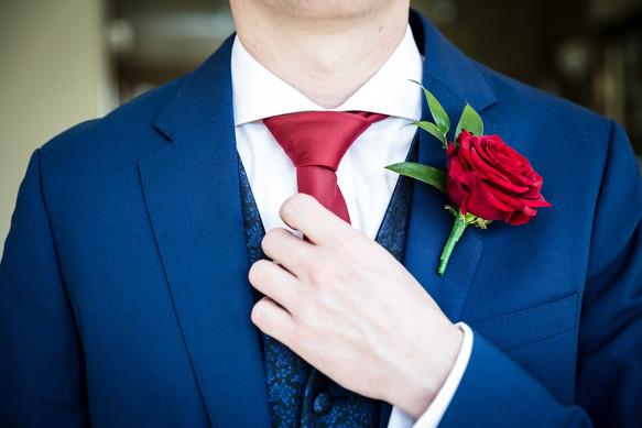 Groom straightens his tie