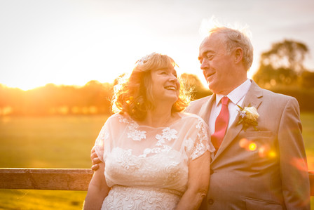 Older bride and groom relaxing at wedding reception
