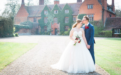 Bride and Groom romantic pose outside Woodhall Manor
