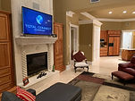 TV wall mount installation over fire place with consolidated remote controls