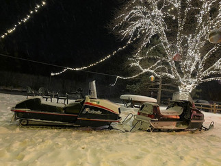 Couple old snowmachines