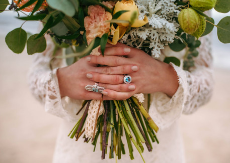 Wade's Jewelers wedding ring on a boho bride at Oak Island Blue Satin Bee