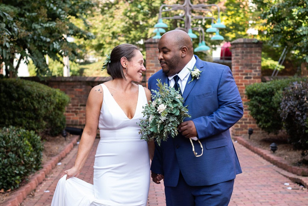 Brittany Butterworth Brookstown Historic Inn Winston Salem Wedding Couple Walking and Smiling