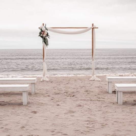 Hen House Photo captured this beautiful Coastal NC wedding elopement package setup on Oak Island, NC