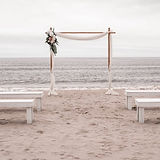 Oak Island wedding elopement package arbor and benches for a beach wedding
