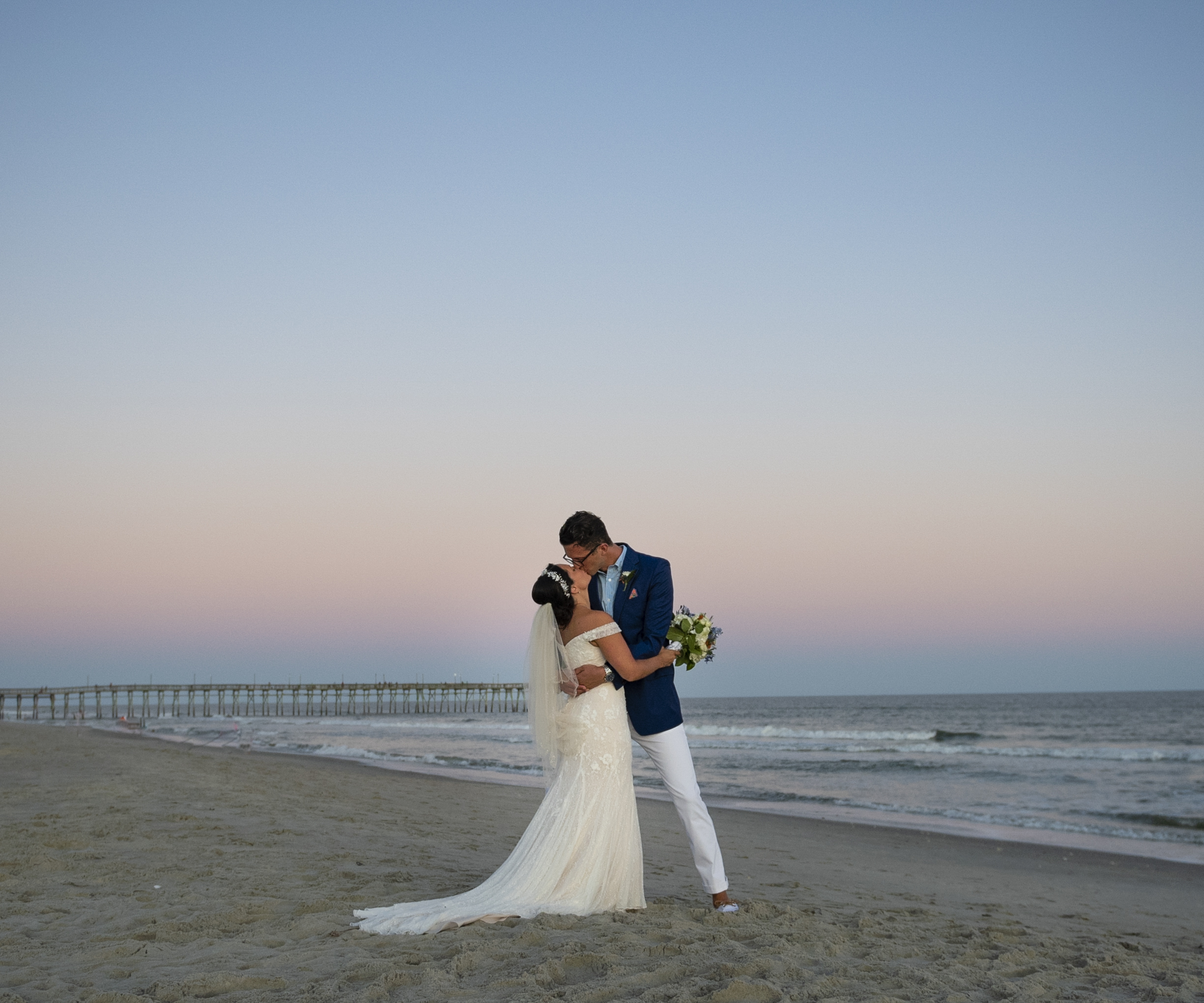 Frank Hart Photography Ocean Isle Beach wedding couple kissing at sunset