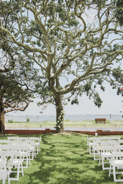 Wedding ceremony in Southport, NC at Cape Fear House overlooking the Cape Fear River Photo by Sarah