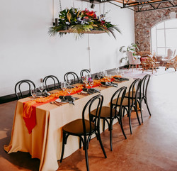 801 Ocean Oak Island, NC Wedding Venue Bright and Bold Tablescape and Lounge Photo by Hen House Phot