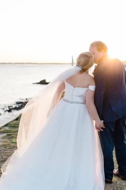 Couple kissing at Southport Waterfront after Southport, NC Wedding at La Polena