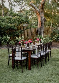 Hen House Photo La Polena Southport NC Wedding Table setup in backyard