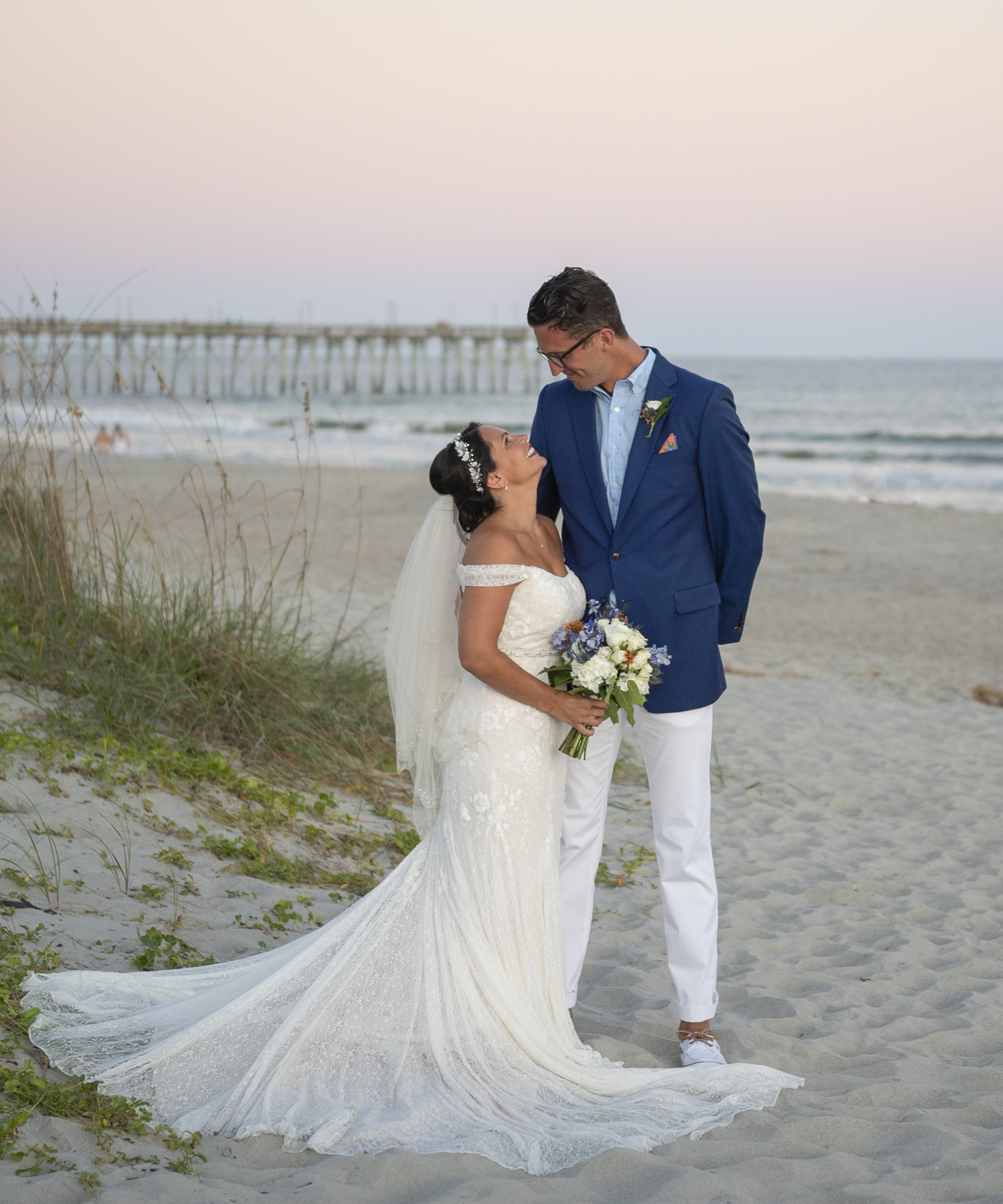 Frank Hart Photography photo of couple at Ocean Isle Inn wedding at sunset.