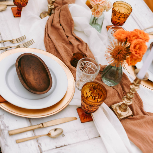 beachy boho wedding tablescape with gold flatware Oak Island, NC wedding planner Blue Satin Bee design