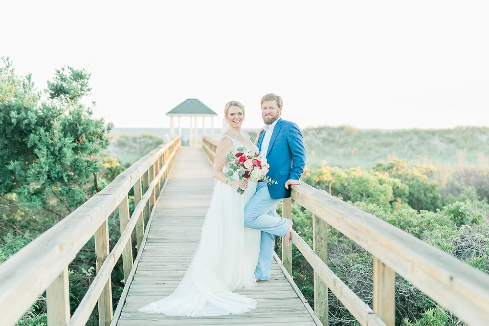 Bride and groom on deck to beach wedding at Oak Island NC Beach elopement package couple for fall beach wedding