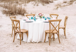 Hen House Photo snaps Oak Island beach wedding tablescape with blush and blue theme