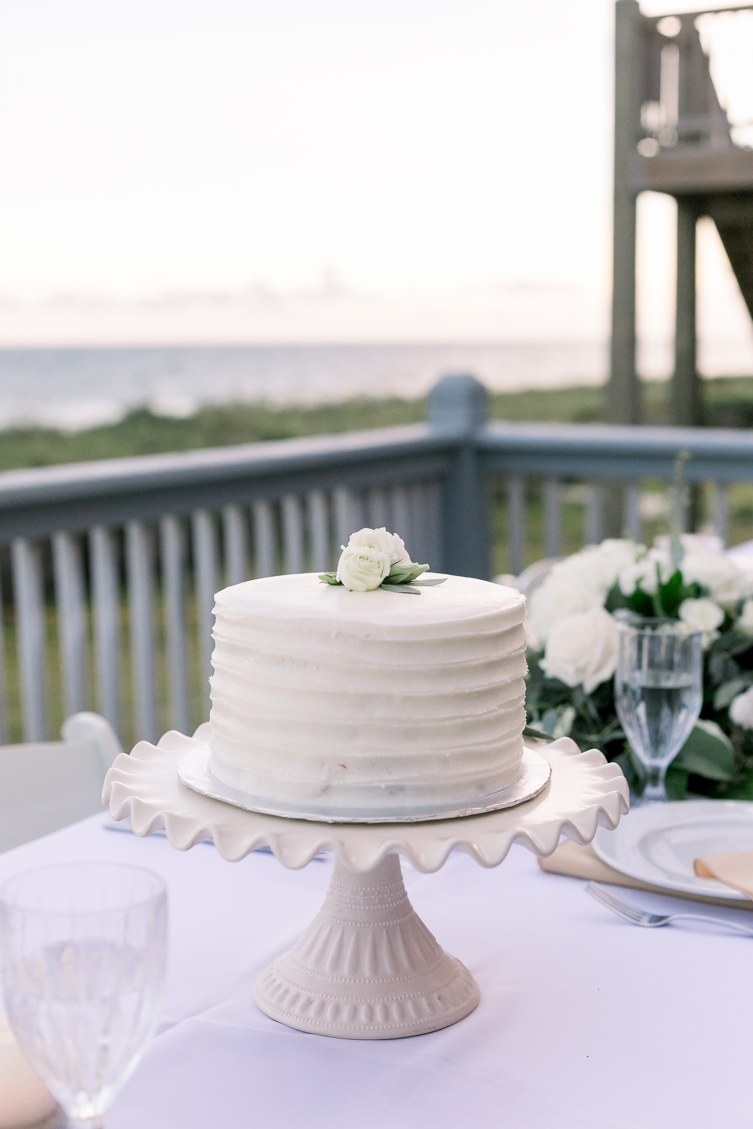 KMI Wedding Cake sits on table for Oak Island NC Beach Elopement