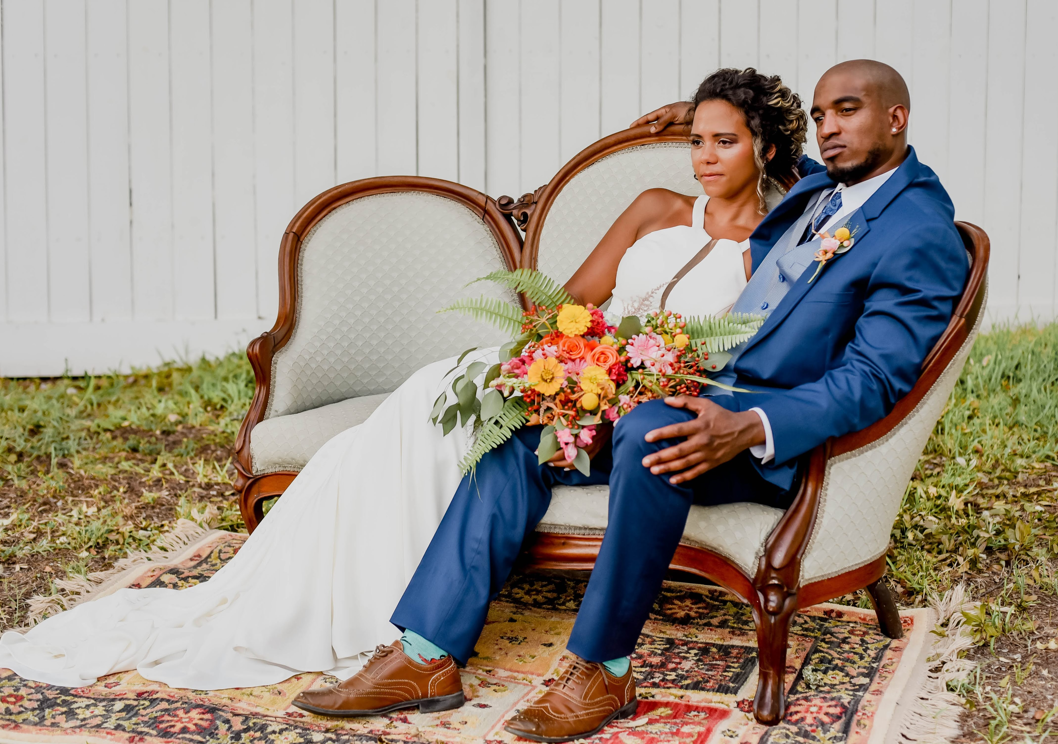 Hen House Photo Couple sitting on Settee Southport Wedding Elopement Package Wedding Lounge Furnitur