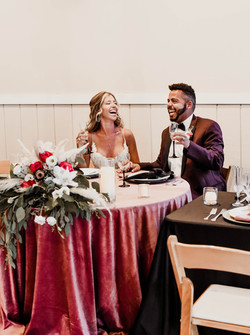 Hen House Photo Southport Wedding Couple laughing at sweetheart table