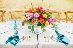 Southport, NC Wedding tablescape and bright floral centerpiece Photo by Hen House Photography