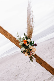 boho floral design on beach wedding arbor by Wild by Nature Southport Wedding florist