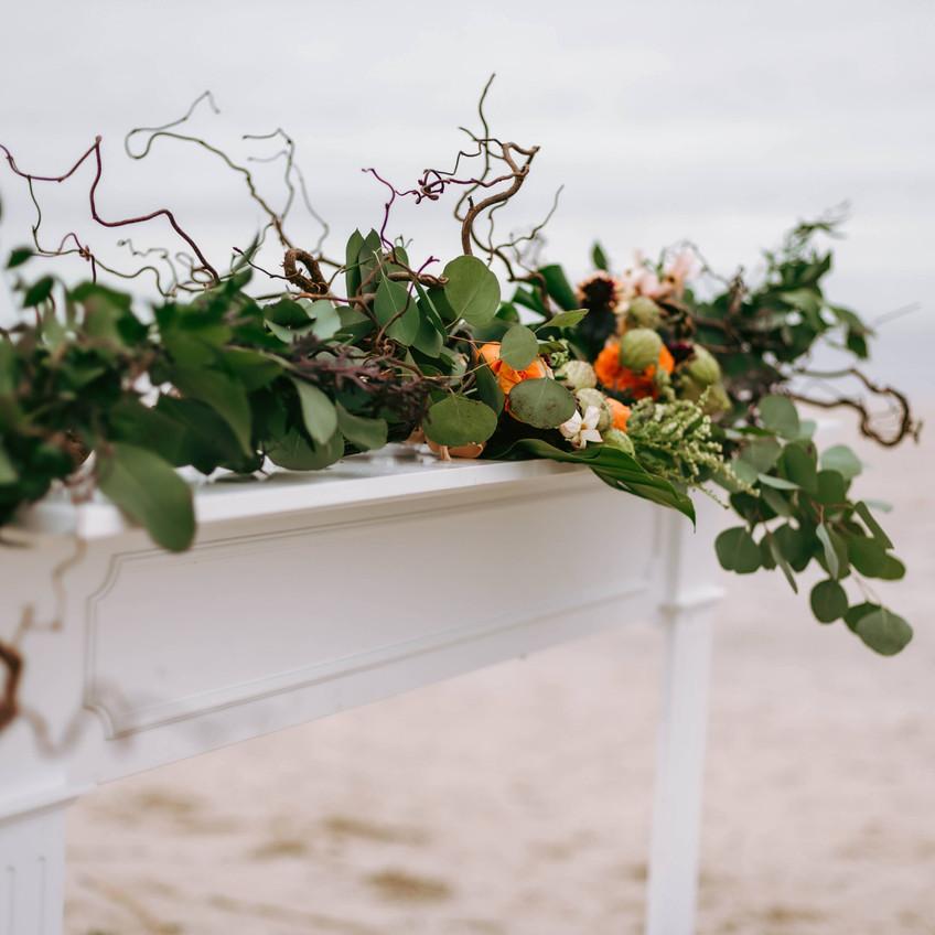 Wedding garland on mantle Oak Island wedding Wild by Nature Hen House Photography Blue Satin Bee