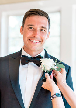 Digital Wunderland captures a groom getting ready at this Southport Community Building wedding