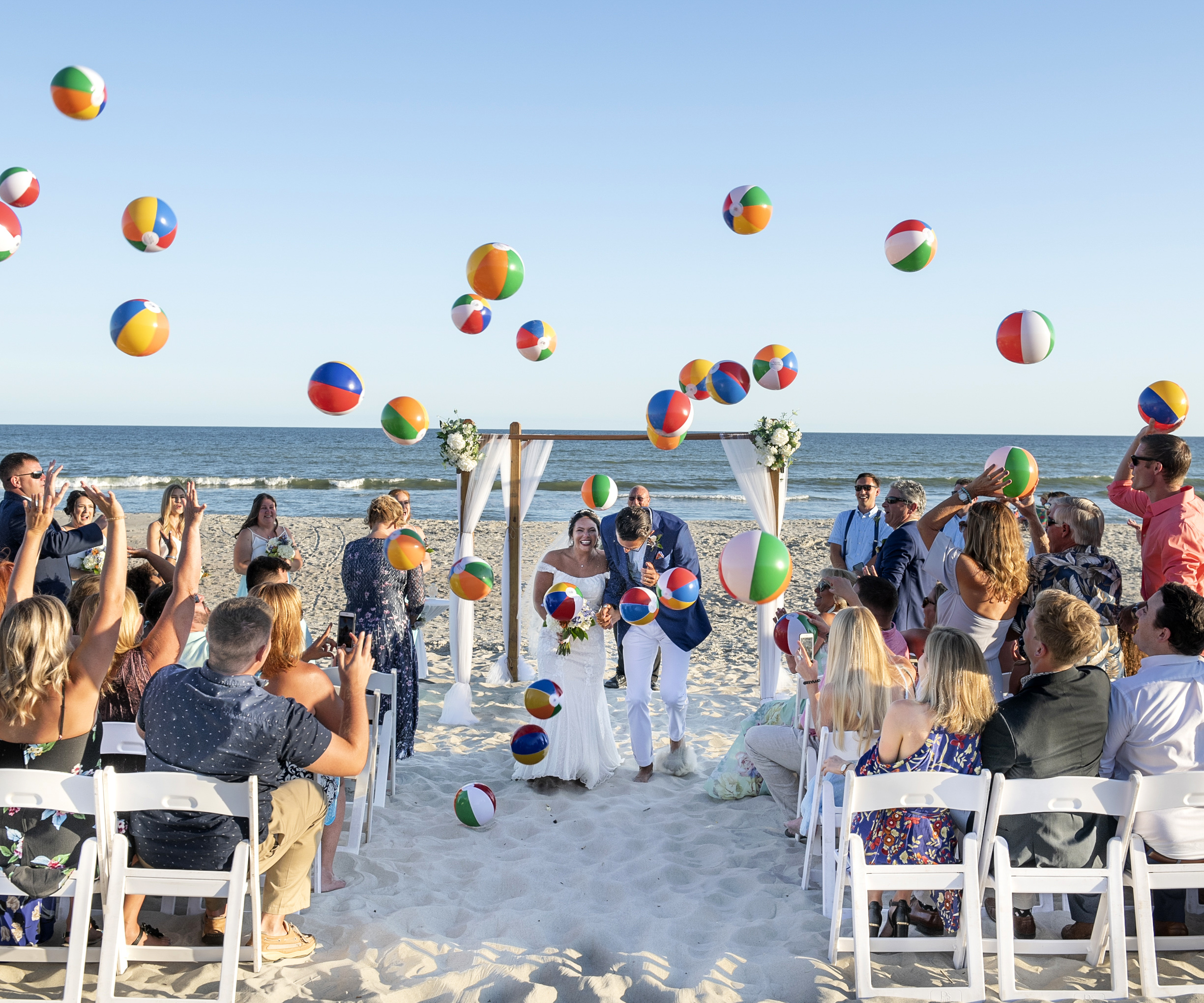 Frank Hart Photography Ocean Isle Beach wedding with fun exit with beach balls