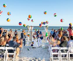 Frank Hart Photography Ocean Isle Beach wedding with fun exit with beach balls
