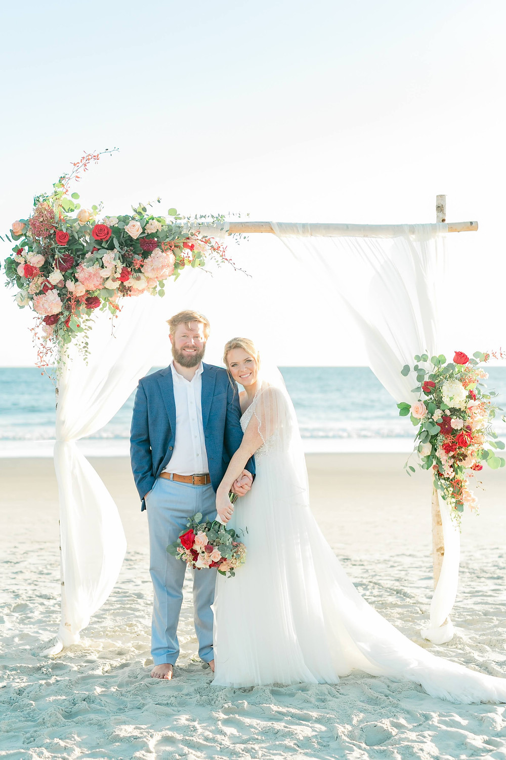 Fall beach wedding couple after beach elopement on Oak Island. Summer Adams Photography and Blue Satin Bee design and planning.