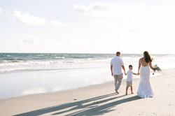 KMI Oak Island beach wedding couple walking with son on beach