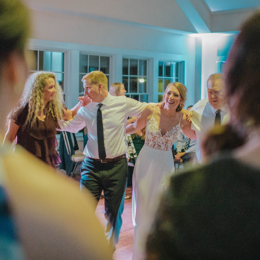 Southport Community Building Wedding couple dancing Digital Wunderland Photography Blue Satin Bee Wedding Management