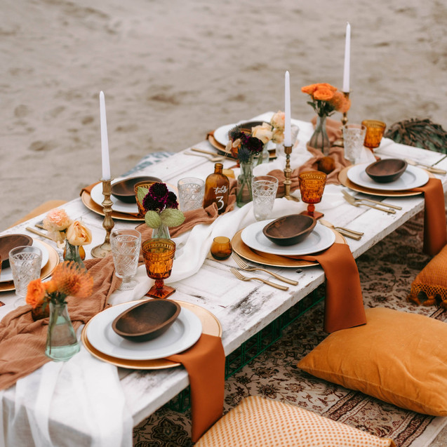 Beachy Boho Tablescape with pillow seating and wooden door tabletop