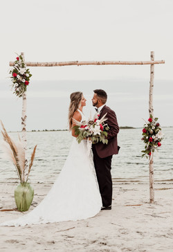 Hen House Photo Southport Wedding Couple at arbor on beach for sunset wedding