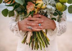 Hen House Photos Wade's Jeweler wedding rings and bohemian beach wedding bouquet at Oak Island