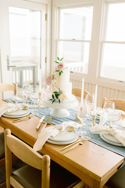 Wedding cake and coastal tablescape for an Oak Island, NC elopement Photo by Chelsea Allegra