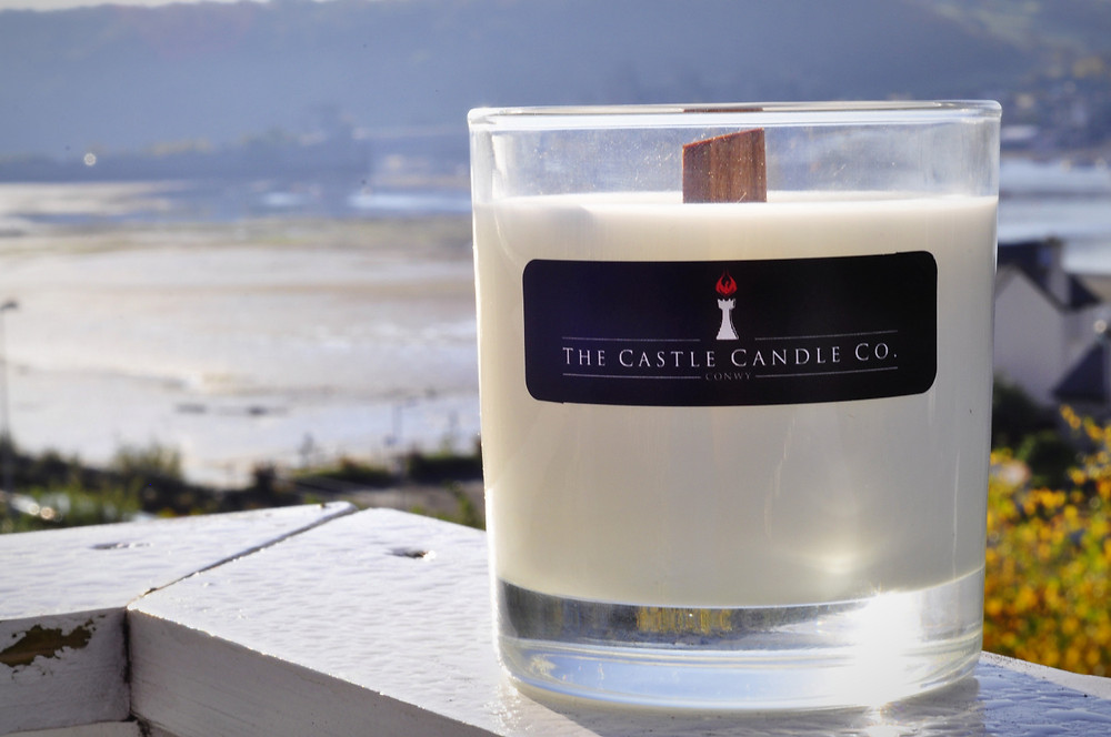 Luxury Soy Candle by The Castle Candle Company with the stunning scenery of Conwy Castle in the background.