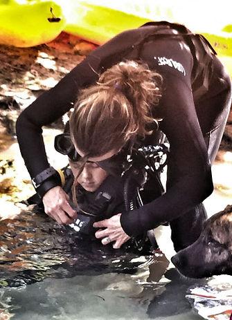 A child starts her scuba certification in a cenote near Playa del Carmen