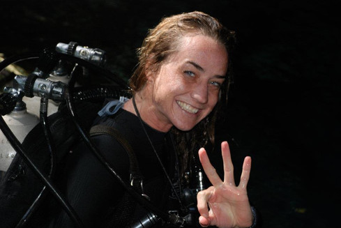 Cave diver about to enter the water at cenote Nohoch Nah Chich