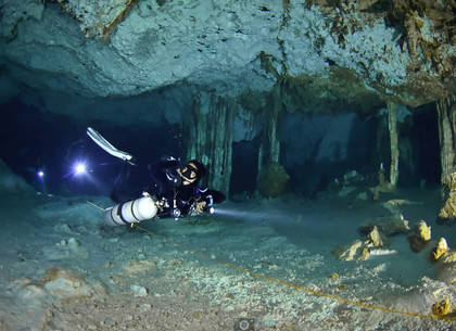 Get wet dive guide Karina is cave diving in Dos Ojos National Park, Mexico