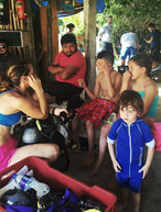 A dive guide gives her briefing for Discover scuba diving at Casa cenote near Tulum