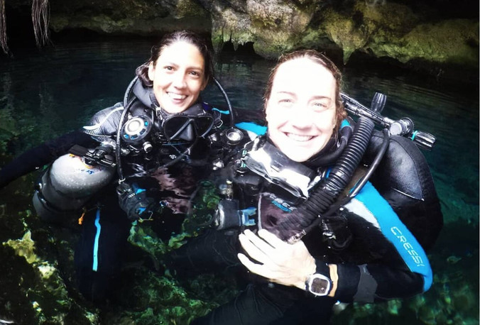Women cave divers after a dive at cenote Nohoch Nah Chich.