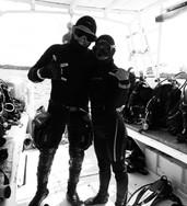 Dive instructors in complete scuba gear on a boat near Playa del Carmen