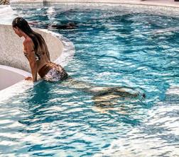 Mermaid freediving in a pool around Tulum