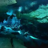 Scuba divers in Dos ojos cenote near Tulum