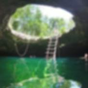 Entrance to cenote Calavera, a cavern dive site just outside Tulum.jp