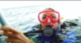 Scuba diver getting her PADI certification in Mexico.