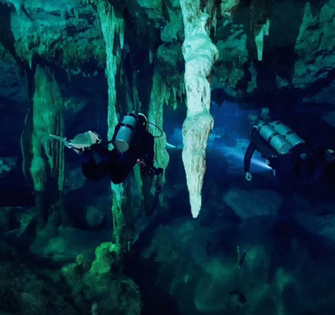 Divers admire the view in cenote the Pit near Tulum